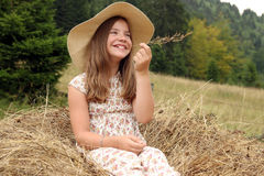Beautiful happy little girl on field Royalty Free Stock Images
