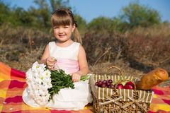 Beautiful happy little girl having picnic in Stock Photos
