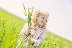 Beautiful happy little girl smiling outdoors Stock Images