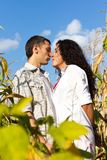 Beautiful happy love couple against blue sky Stock Photo