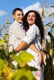 Beautiful happy love couple against blue sky Stock Images