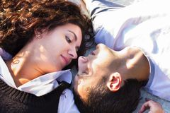 Beautiful happy love couple lying Royalty Free Stock Images