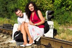 Beautiful happy love couple on rails Stock Image