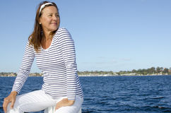Beautiful happy mature woman water background Stock Image