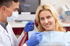 Mature woman visiting dentist at the clinic stock images