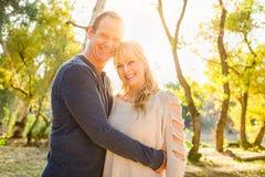 Happy Middle Aged Caucasian Couple Portrait Outdoors. Beautiful Happy Middle Aged Caucasian Couple Portrait Outdoors royalty free stock image