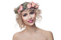 Beautiful happy model woman wearing flowers crown isolated on white background. Curly Hair, Makeup and Flowers stock photography