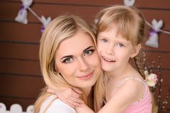 happy mom and daughter blonde hugging stock photo
