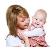 Beautiful happy mother with baby royalty free stock photography