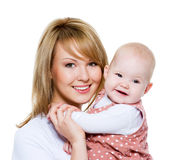 Beautiful happy mother with baby Royalty Free Stock Photos