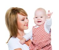 Beautiful happy mother with baby Stock Images