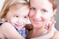 Beautiful happy mother and her little daughter Royalty Free Stock Photos