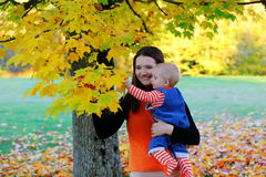 Beautiful happy mother hugging baby girl with love Royalty Free Stock Images