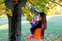 Beautiful happy mother hugging baby girl with love Stock Image