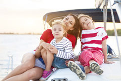 Beautiful happy mother with two daughters having great time at t stock photos