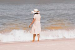 Beautiful happy multiracial Asian girl in vintage dresses standing. Beautiful happy multiracial Asian girl in vintage dresses relax and standing on the beach royalty free stock photos
