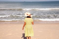 Beautiful happy multiracial Asian girl in vintage dresses standing. Beautiful happy multiracial Asian girl in vintage dresses relax and standing on the beach stock image