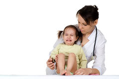 Beautiful happy nurse with a girl sitting Royalty Free Stock Image