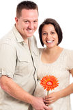 Beautiful happy pregnant couple with flower Royalty Free Stock Photography
