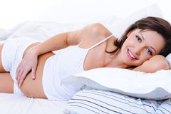 Beautiful happy  pregnant female  touch her tummy Stock Photography