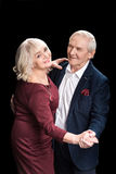 Beautiful happy senior couple dancing royalty free stock images