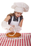 Beautiful happy seven year old girl in chef uniform with shortca Royalty Free Stock Photos