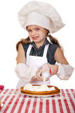 Beautiful happy seven year old girl in chef uniform with shortca Stock Photography