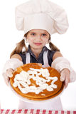 Beautiful happy seven year old girl in chef uniform with shortca Royalty Free Stock Image