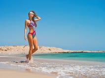 Beautiful happy slender woman at sea royalty free stock photos