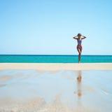 Beautiful happy slender woman at sea Stock Image