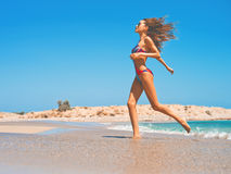 Beautiful happy slender woman at sea Stock Photos