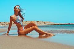 Beautiful happy slender woman at sea Royalty Free Stock Image