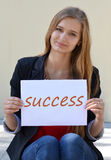 Beautiful,happy,smiling blonde girl with long beauty hair and the inscription,note Success. Royalty Free Stock Images