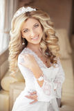 Beautiful happy smiling bride young woman with wedding makeup an Stock Images