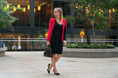 Beautiful happy smiling business woman walking for work to the office. stock photos