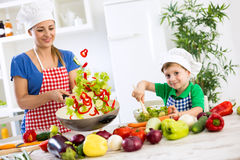 Beautiful happy smiling family cooking vegetables meal. At home royalty free stock images