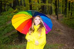 Beautiful happy smiling girl with long hair wearing stylish jacket posing in autumn day. Happy young woman in park on. Sunny autumn day. Fashion photo of young stock photo