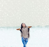 Beautiful happy smiling girl woman walking in a field on a winter evening, and happy snow Stock Photo