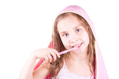 Beautiful happy smiling little girl brushing her teeth after bath, shower Royalty Free Stock Photo