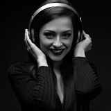 Beautiful happy smiling long hair young woman listening the musi Royalty Free Stock Images