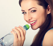 Beautiful happy smiling makeup woman holding and drinking water Stock Photography
