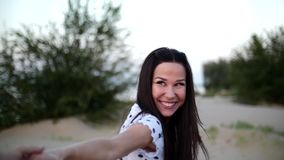 Beautiful Happy Smiling Stylish Joyful European Cute Young Girl in White Blouse And Long Dark Smooth Well-Groomed Hair. Holding Hands with her Beloved Running stock video
