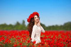 Beautiful happy smiling teen girl portrait with red flowers on h Stock Photo