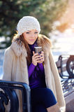 Beautiful Happy Smiling Winter Woman with Mug Outdoor Royalty Free Stock Photos