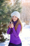 Beautiful Happy Smiling Winter Woman with Mug Outdoor.  Stock Image