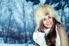 Happy girl with cup of tea in the winter park royalty free stock images