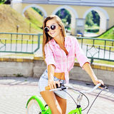 Beautiful happy smiling young girl on a bicycle Royalty Free Stock Images