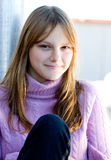 Beautiful happy smiling young teen girl portrait. Portrait of a beautiful happy smiling young teenage girl with blond hair and bang Stock Images