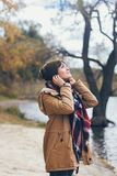 A beautiful happy smiling young woman in the autumn park Stock Photo