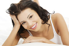 Beautiful happy young woman in bed Royalty Free Stock Photography